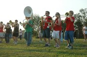 Members of the Lansing High School marching band will be under the tutelage of their third band director in three years wen they take the field Friday night to perform the halftime show at the football game.