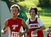 Sophomore Griffin Davis chased down a Tonganoxie runner early in the varsity boys' race.