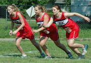 Lori Flippo, Briana Zak and Elizabeth Parks break from the starting line at the beginning of the JV girls' race on Thursday at Tonganoxie.