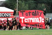The Lansing High cheerleaders made it clear what they wanted the Lions to do to Tongie on Friday night.