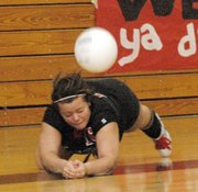 Senior Keele McLaurin dives for a dig during the first game against Shawnee Mission West.