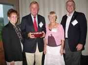From left are Terri Ulin, Retired Gen. Peter Carstens, Heide Carstens and  Robert Ulin, a retired U.S. Army colonel, current faculty member at the Command and General Staff College at Fort Leavenworth and  Lansing City Council member. The Ulins were hosts and the Carstens were honored guests at a reception of the SHAPE Officers Association on Friday, Sept. 9, in Lansing.