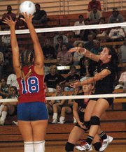 LHS junior Riann Deere smashes a kill against Santa Fe Trail.