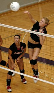 Senior Casey Welch smashes a kill during Lansing's victory against Blue Valley at the Louisburg Tournament.