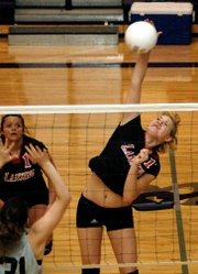 Senior Casey Welch smashes a kill down the line on Saturday at the Louisburg Tournament.