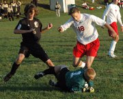 LHS junior Steffen Schumann collides with Turner's goalkeeper during Lansing's 2-0 victory on Wednesday evening.