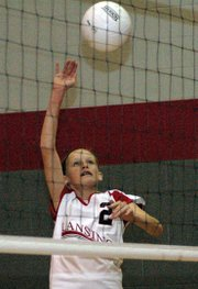Madison Brandt goes up for a spike during the eighth-grade A team's victory against Lexington Trail.