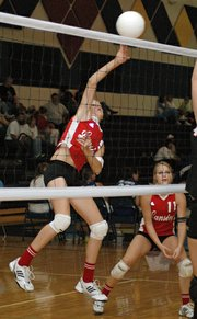 Brittney Lang puts down a spike against Bishop Ward at the Kaw Valley League JV Tournament.