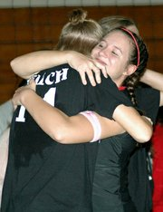 Junior Riann Deere gives senior Casey Welch a hug during the Senior Night ceremony.