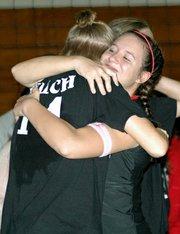 Junior Riann Deere gives senior Casey Welch a hug during the Senior Night ceremony.