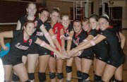 The Lansing High volleyball team was all smiles after hammering Mill Valley and Tonganoxie on Senior Night at LHS.