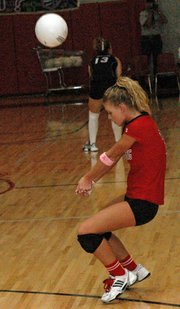 Dayna Norwood returns a serve during Lansing's victory against Mill Valley.