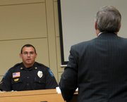 Lt. Ben Ontiveros of the Lansing Police Department is questioned on the witness stand during the trial of the man suspected in the December 2004 robbery and rape of a clerk at Wood Oil Co. A mistrial was declared, and a new trial set for Nov. 14.