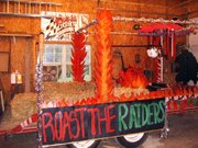 "The freshman class float has a theme ""Roast the Raiders."""