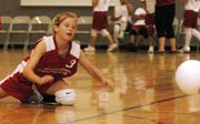 Seventh-grader Megan Wilcox dives as she tries to dig a ball during the match against Xavier.