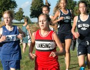 Lansing High senior Erin Eustice battles her way through the pack to a 12th place finish at the Kaw Valley League meet.