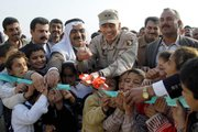 Then-Maj. Gen. David Petraeus cuts the ceremonial ribbon to mark the grand opening of the Al Hasoodia School in January 2004 in Kanash, Iraq. Petraeus, now a lieutenant general, takes over command of Fort Leavenworth today, Oct. 20.