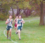 Tanner McNamara (left) and Adam Justice held off Eudora's Cody Burns Saturday at the regional cross country meet. McNamara won the race while Justice used a late sprint to secure second.