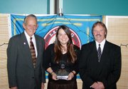 Shanae Randolph, center, the city's director of Economic Development/Convention and Visitors Bureau,  is flanked by Mayor Kenneth Bernard, left, and City Administrator Mike Smith after being named the city's Employee of the Year for 2005.