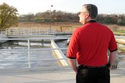 City Council member David Trinkle Jr. looks out over an aerator built as part of the expansion of Lansing's Wastewater Treatement Plant. A ribbon-cutting Monday, Nov. 7, marked the completion of the $15.8 million expansion, which nearly triples the plant's capacity.