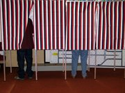 Voting booths like these slowly will be phased out as Leavenworth County begins purchasing electronic voting machines.