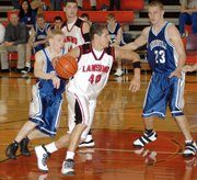 Lansing High senior Matt Warner drives to the basket during Lansing's 74-55 victory against Harrisonville.