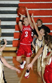 Lansing High sophomore Morgan Chiles goes up for two points during the third quarter Wednesday night against Savannah.