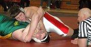 Lansing High senior Logan Ryan pins his opponent from Basehor-Linwood while wrestling at 275 pounds.