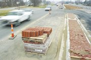 Parkway problems: paving brick in bundles wait along Shawnee Mission Parkway as construction came to a close in the spring after several months later than orignally contracted.