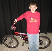 Jack Bresser won this bike from a  Boys and Girls Club outreach program.