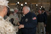 Vice President Dick Cheney shakes hands as he greets service members after speaking to U.S. Marines, sailors, and soldiers in a hangar on Al Asad Air Base, Iraq, on Dec. 18, 2005. Cheney will make a trip to Fort Leavenworth to meet with troops on Friday.