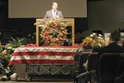 Pastor John Hull speaks to those attending the funeral of J.B. Stinnett.