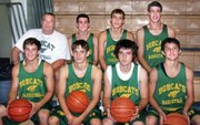 J.B. Stinnett (left rear) with members of this year's BLHS basketball team.