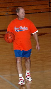Mike Worral, LHS class of 1971, brings the ball up the court during the alumni basketball tournament.