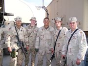 Sgt. Brett Dolinski, Lansing, second from right, is shown with members of his unit in Iraq.