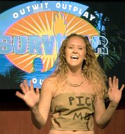 Ashlie Beck of Grain Valley, MO showed her special beach outfit she had under her clothes for the Survivor audition Friday.