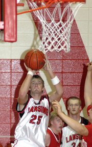 Lansing High senior Chris Wagner puts up a jump shot Saturday during Lansing's 56-44 victory against Tonganoxie.