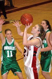 Lansing High senior Amanda Radovich goes up for two of her game-high 20 points against Immaculata.