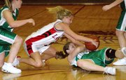 Lansing High sophomore Amanda Darrow battles for a loose ball with Immaculata's Christina Winkelbauer.