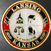 The front of the official city coin features Lansing's seal
