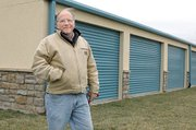 Hank Koch stands outside the Ensign Storage Facility in Bonner Springs. Koch led authorities to the van used by Toby Young to smuggle inmate John Manard from Lansing Correctional Facility on Sunday.