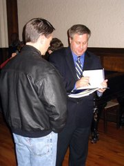 Michael Lind autographs a book after he delivered the Lincoln Lecture at University of St. Mary.