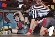 Sophomore Dennis Wood was thrown under the scorer's table during his first-round victory at 103 pounds.