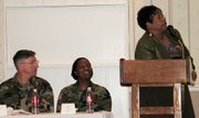 Joyce Williams, right, keynote speaker at the Combined Arms Center and Fort Leavenworth African American/Black History Month Celebration, makes a point under the watchful eyes of Chaplain (Lt. Col.) R. Terry Meek, left, and Maj. Karen Scott. Williams, a Lansing resident, spoke at the celebration Friday, Feb. 24.