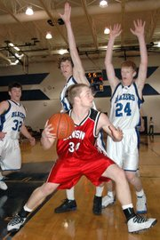 Lansing High senior David Kern looks for room to operate under the basket during the first half against Gardner.