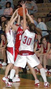 Lansing High senior Rachel Darrow ran into trouble against Shawnee Heights' tough defense during the second half Saturday.