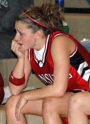 Sophomore Katie Nietzke showed her frustration and sadness during the final minute of Lansing's loss to Shawnee Heights in the substate finals.