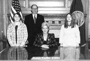 Lansing Middle School students Lauren Hamilton, far left, and Lacey Aufdemberge, far right, had their pictures taken with Gov. Kathleen Sebelius, seated, when they were pages for Lansing Rep. Kenny Wilk, also pictured, last month in Topeka.