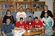 Lansing High baseball players Jeff Terrill and Mike Amaral signed on Feb. 27 to play college baseball at Highland Community College. At the signing ceremony were, from left, front row: Jon Terrill, Jeff Terrill, Donovan Amaral, Mike Amaral and Hillary Amaral. Second row: Lisa Terrill, Randy Terrill, head coach Troy Andrews, assistant coaches Jake Hanson and Dustin Myers and Suzie Amaral.