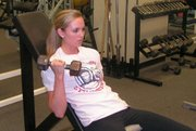 Ashley Aull goes through weight training as part of her preparation for the Miss USA 2006 pageant, which is later this month in Baltimore.